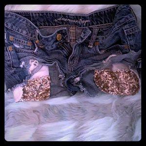 American eagle destroyed blue jean shorts